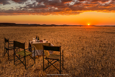 There are two focal points in this image - the table and chairs, and the sun. Notice how your eyes move from one to the other across the diagonal and, importantly, into and out of the image. This is because we are looking at a distant object (the sun) and a close one (the table and chairs).