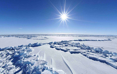 This is one of the landscapes which would have confronted the early explorers of Antarctica, seemingly endless sea ice, interrupted by pressure ridges, sastrugi (the wind blown lines of snow) and the occasional open water lead in the ice, under a cloudless sky and blinding sun.