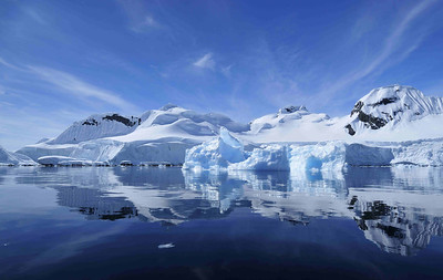 Cruising or kayaking through the glassy waters of the bays on the Peninsula is one of the highlights of Antarctic tourism. On a still big blue day, you can imagine yourself as alone in the world, contemplating the reflections of the myriad shades of blue produced by the ice.