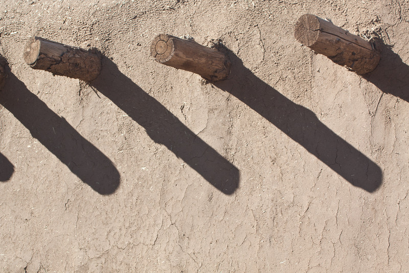 Afternoon shadows on an old adobe house.