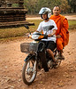 Senior Buddhist Monk Arriving at Angkor Wat via Motorcycle