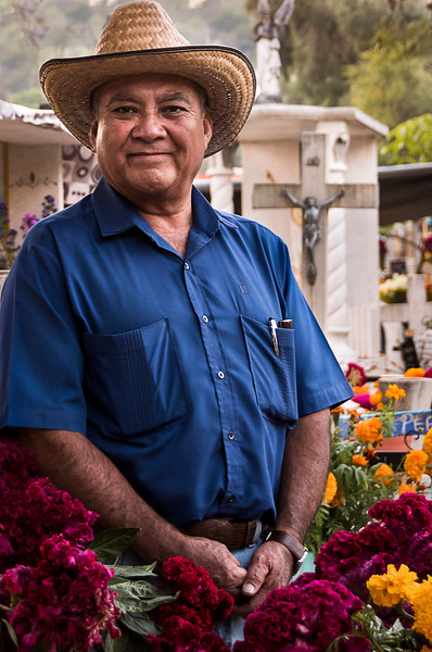 An Oaxacan man poses in a cemetery