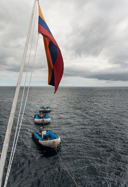 Day 3 Floreana Island in the Galapagos Islands with ship flag & zodiac boats