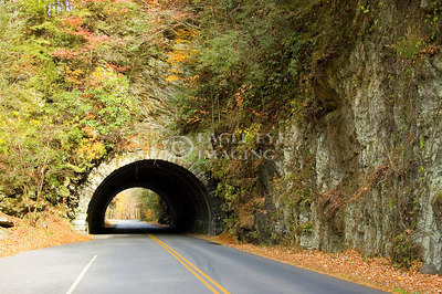 A vehicle heads towards a tunnel in a mountainside in Tennessee