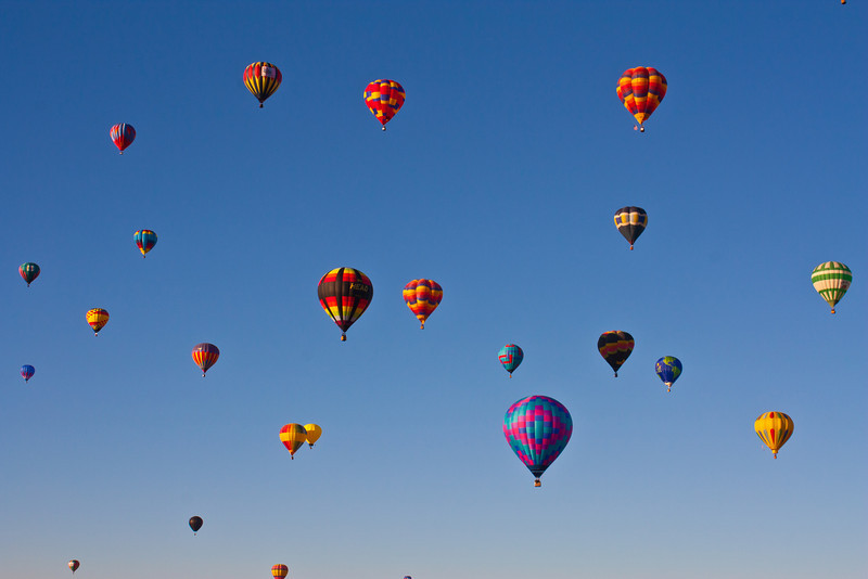 The sky is filled with hundreds of balloons, what a sight.