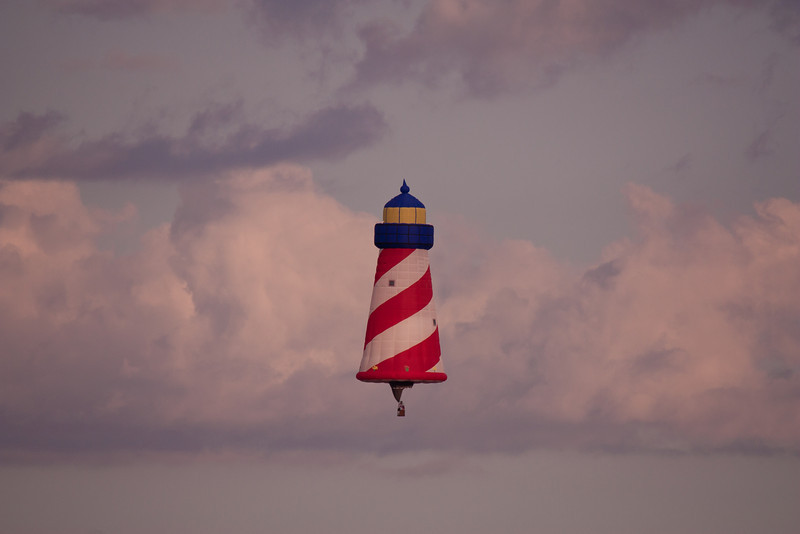 This very large lighthouse balloon drifted along with a few colorful clouds.