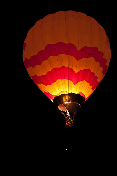 Each balloon releases their lines and the balloons lift off into the night.  They cannot be seen until they turn on the gas to give them lift.