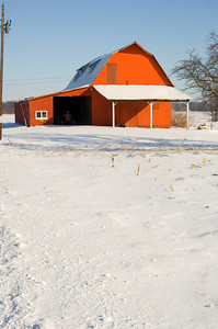 A red barn stands out against the snow-covered ground following a winter storm in Illinois.