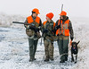 Upland game bird hunting, pheasants, hunters, 14-year-old Tyler Lauber, 11-year-old Trevor Lauber and Jane Freeman, share, enjoy a moment in the field, after killing a rooster pheasant,