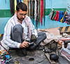 The Shoe Repairman in Palace of the Winds Market