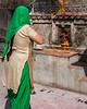 A Worshipper at Jagdish  Temple - Udaipur - Colored Powder Remains after Holi Festival