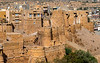 The sandcastle-like Jaisalmer Fort seemingly rises from the ground