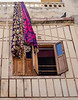 Colorful Clothes Hang from a Balcony in Jagdish Temple - Udaipur