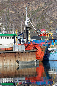 Colourful harbour reflections at Sisimiut. This ship was definitely undecided as to its preferred colour.