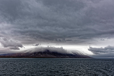 Threatening clouds presaging high winds at Naval Board Inlet, heading across Lancaster Sound to Devon Island.
