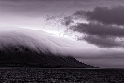 Moody landscape with ominous clouds at Pond Inlet, Baffin Island. Selenium tones after infrared conversion.