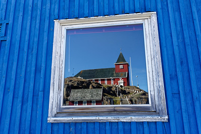 The church at Sisimiut framed in reflection from a building lower down the hill.