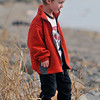 Wyatt gets a close look at the frozen carp at Quivira Wildlife Refuge.
