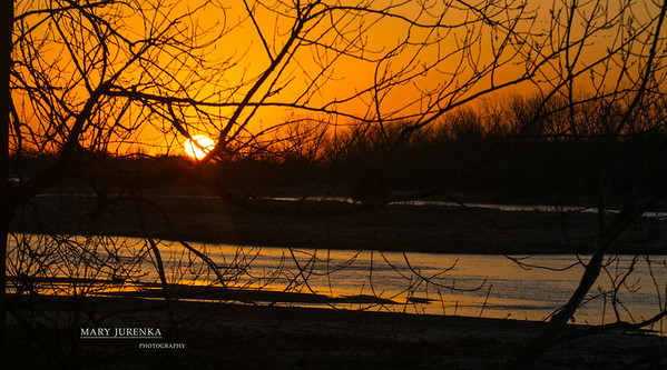 The sun rises on the Platte River during the annual Sandhill Crane Migration