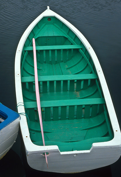 The colors of this boat are very attractive.  It just touches the corner of the blue boat setting off contrast and changing its angle.  This is an interesting and appealing image.