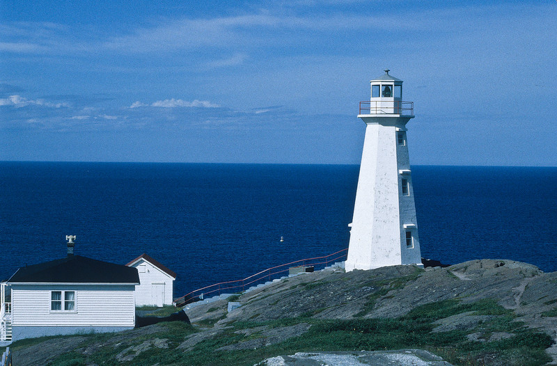 Alonely lighthouse from the Canadian maritimes.  It has been the guardian of the sea for many a fishing boats.