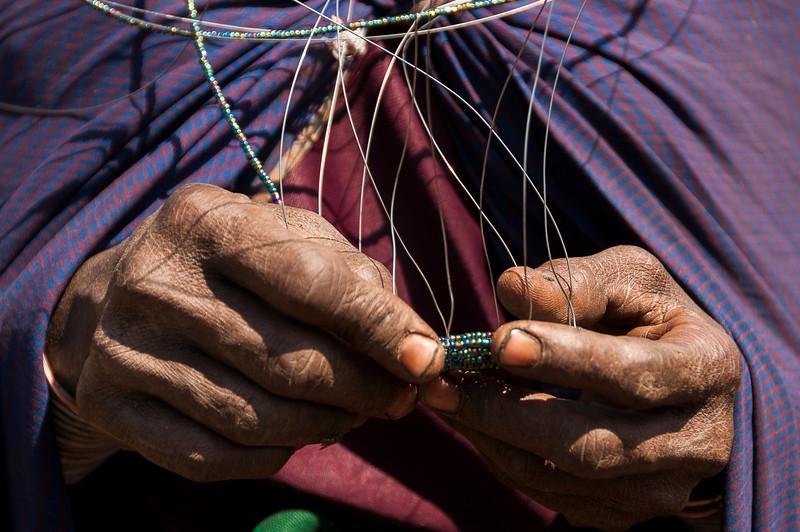 Maasai Village at Ngorongoro Crater - Maasai Woman Making Jewelry