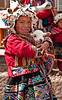 Cusco - The Sacred Valley of the Incas - Andean child with pet goat at Pisac Market