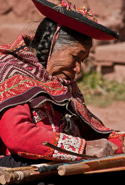 Cusco - The Sacred Valley of the Incas - Andean weaver at a Fiber Farm
