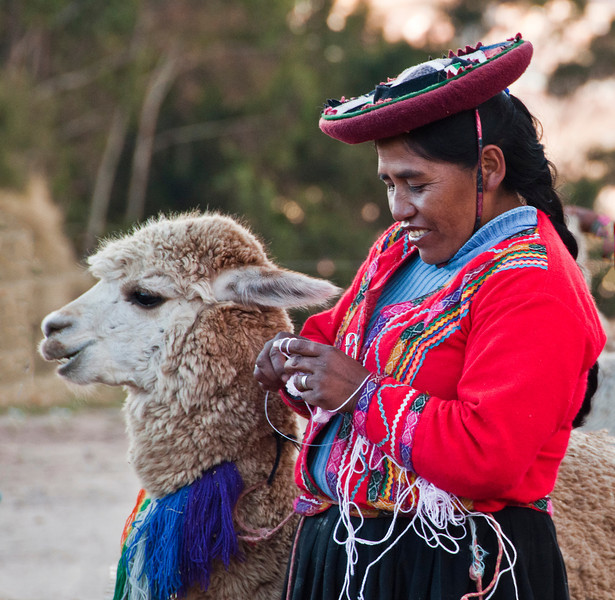 Day 1 Cusco - Andean woman with llama and children at Sacsayhuaman site