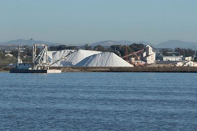 South Bay Salt Works plant, with stockpiles of salt and dredge.