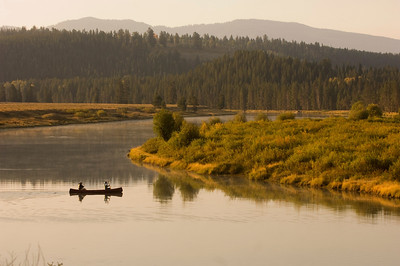 A canoe makes its way along a stream in Grand Teton National Park, Wyoming