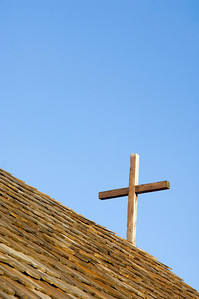 A wooden cross on the roof of an old church in Grand Teton National Park
