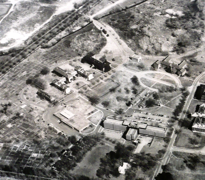 1967: Aerial view of the Boston State Hospital, showing modern new buildings in the foreground, the continuing presence of agricultural activity on the left, and the resurgence of the marshland at the rear of the photo. <em>Courtesy of the Massachusetts Archives.</em>
