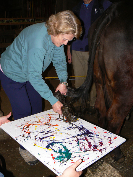 "Here Christy Foote-Smith creates some ""Farm Art"" with Louise the cow. The painting was auctioned off at our fall fundraiser, A Moovable Feast."