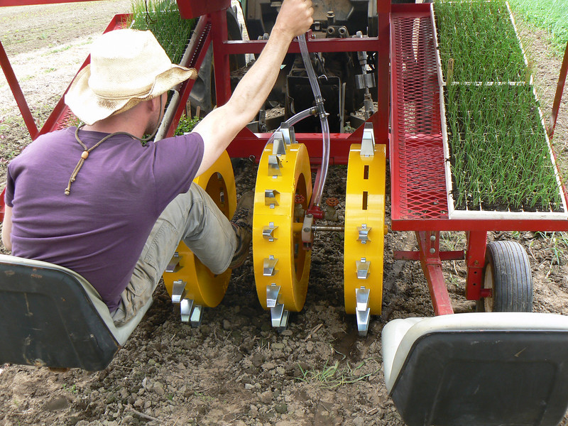 The water wheel transplanter arrived in May and was a big help to the crops team in planting all those seedlings.
