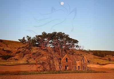 Watervill house at sunrise moon set.