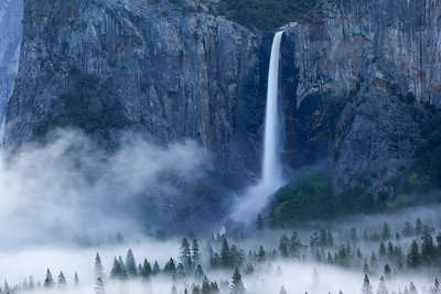 like a garden hose of hot water on a cold winter morning, the falls actually are filling the valley with fog.  Exposed entirely with moonlight.