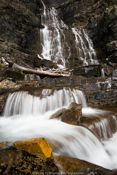 A block of gold rests beneath a remote waterfall in Waterton Lakes National Park.