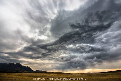 Strange clouds forming where the prairies meet the mountains.