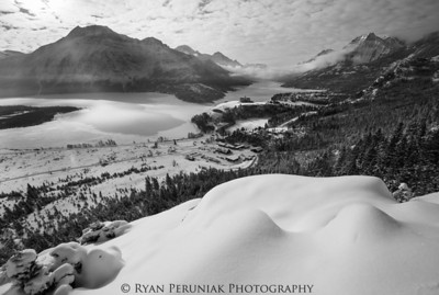 After a mild winter, Waterton is finally blanketed with a layer of snow and its lakes are frozen over.