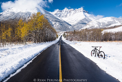Mountains, fall colours, an early snowfall, a freshly plowed road…and a bike.  Anyone care to go for a ride?