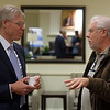President Will Dudley in conversation with Greg Cooper, professor of philosophy, at the reception prior to the president's remarks.