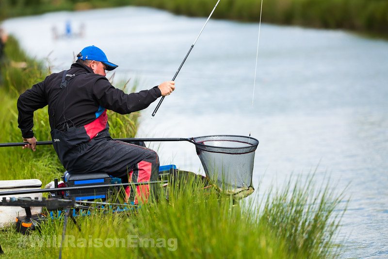 Will Raison lifts a carp from the water in the landing.