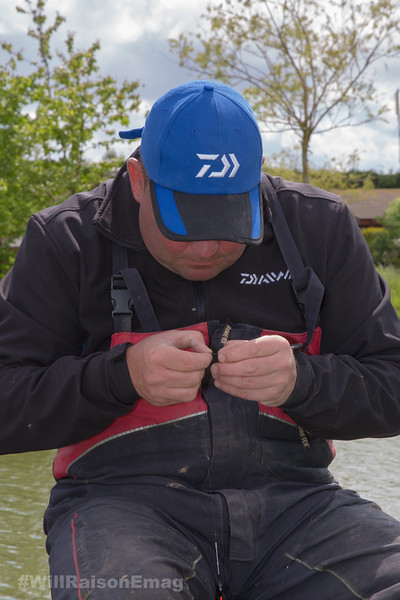 Will Raison attaching a hook length to a pole rig.