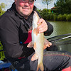 Will Raison displays a fine barbel of several pounds.