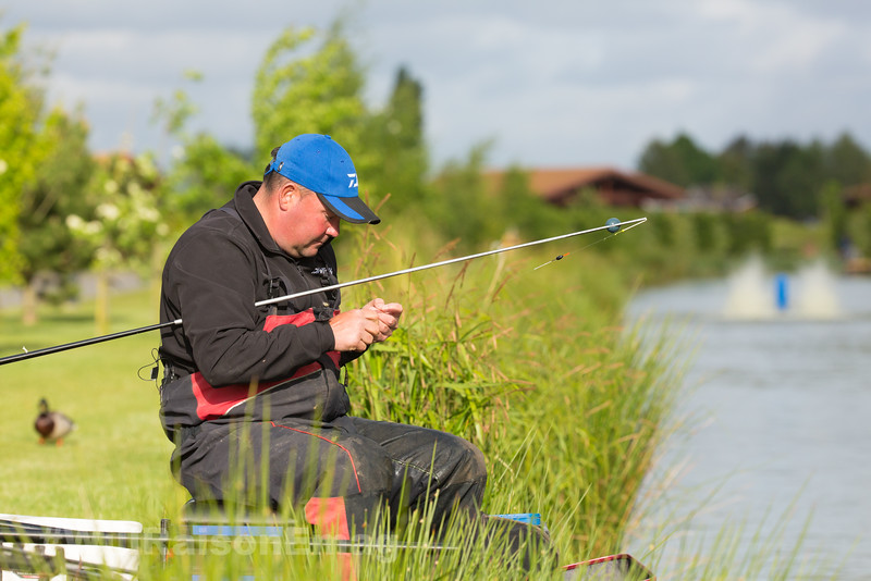 Will Raison baiting up a pole rig.