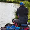 Will Raison hooks barbel in the nearside margin beside the pond grass.