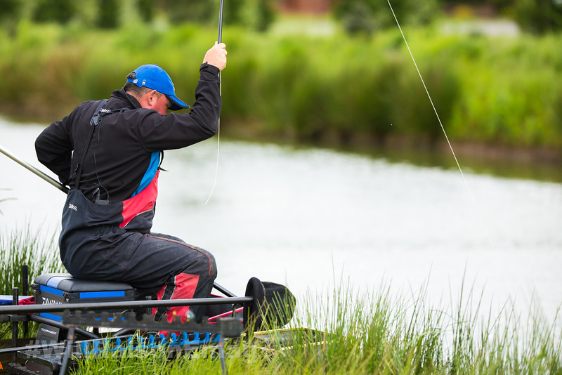 Will Raison playing a barbel on a silver painted topkit and white Hydrolastic  on a commercial  canal style lake. Skylark at Westwood Lakes, Boston Lincs.