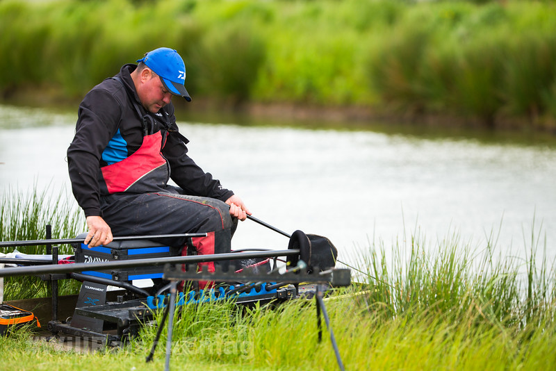 Will Raison unships the no 4 form the top kit having hooked a barbel in the near margin.