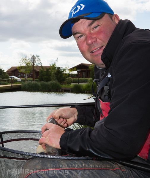 Will Raison unhooks a carp. Westwood Lakes, Boston, Lincs.